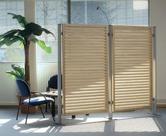 Solid timber screen frame and horizontal profiled slats.  Profiled aluminium outer posts.  These screens are ideal for offices and reception areas. Timber Screens, Reception Areas, Bespoke Design, Trellis, Offices, Layout, Flooring, Frame, Furniture