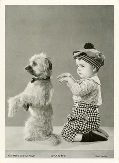A dog and a baby named Spanky strike a pose | Community Post: 30 Strange But Delightful Vintage Photos Of Animals - what a great name!