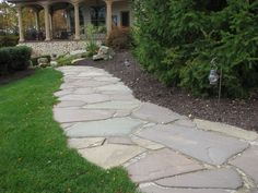 Flagstone Walkway Design Ideas cut flagstone walkway with small gaps about 1 inch that makes this walkway fairly formal for walking on yet the edges have been cut to blend in Flagstone Walkway With Organic Edge