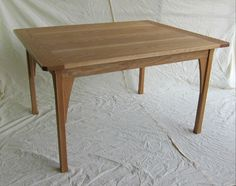 Dining table designed and handmade from oak by davidtowers.biz