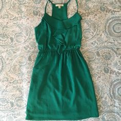 Green dress from Lush (Nordstrom brand) Short green dress from Lush. It was purchased at Nordstrom. The dress has pockets and is in good condition. Lush Dresses Midi