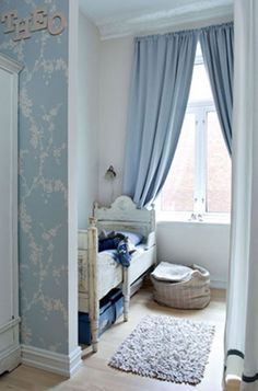 """Swedish inspired tiny bedroom.  I love the silver and blue vining wallpaper, and """"Theo"""" on the wall- that's my first pick for a baby boy name :)"""