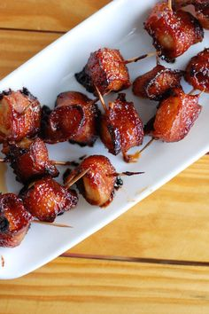 Water chestnuts wrapped in bacon with the most delicious sauce drizzled over top. These bacon wrapped water chestnuts are always the first thing to go at a party.