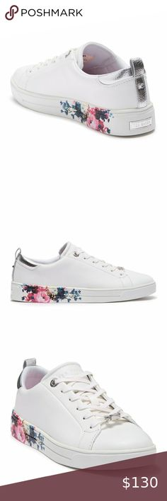 Ted Baker Roully Floral Print Sole Sneaker, 11.5 New with tags and box! Beautiful, just not quite right for me.   Sizing: True to size. - Round toe - Leather construction - Floral print sole detail - Lace-up - Back pull-tab - Padded footbed - White sole - Grip sole - Imported  Materials Leather upper, manmade sole Ted Baker London Shoes Sneakers London Shoes, Pumps, Heels, Jewelry Organization, Fashion Tips, Fashion Design, Fashion Trends, Ted Baker, Floral Prints