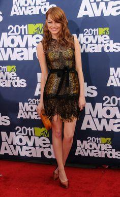 Emma Stone - 2011 MTV Movie Awards Bottega Veneta dress, clutch, and earrings combined with Casadei shoes.