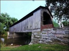 Mull Covered Bridge: An 1842 Town lattice bridge reaches 100 feet across the East Branch of Wolf Creek on County Road 9-0 near Old Fort, Ohi...