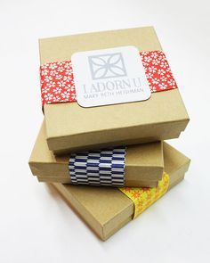 Packaging Idea for Jewelry - Kraft Boxes, Strip of Scrapbook Paper, and Sticker on Top! Secure Paper with Glue Stick on Bottom of Box.