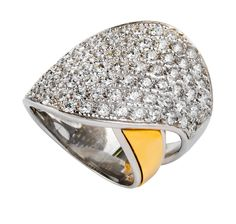 Ring in polished silver with polished gold on the side. Stone Setting of the part on the top with white zirconias.