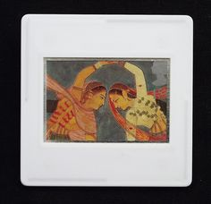 This delicate and beautiful painting made during the Mughal Aurangzeb period c.1675, is printed as one of the set of ten Royal Mail postage stamps called 'Greetings Clown' issued in 1995. The unused stamp is titled 'A Pair of Girls with Joined Hands Performing a Kathak Dance'. The image is encased in a vintage slide mount, with glass, making this a unique piece of jewellery.