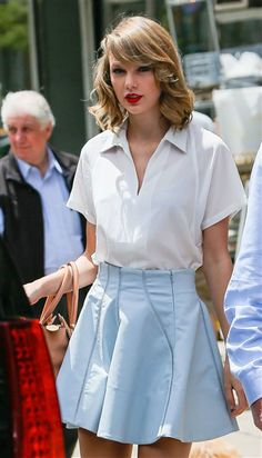 Taylor Swift wore a whimsical ensemble -- consisting of a white blouse and a light blue skirt -- after a day at the gym in New York on May 24, 2014. She kept her light look simple with a red lip and waves in her hair.