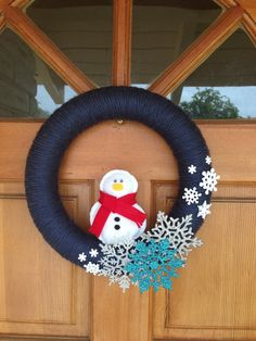 handmade snowman wreath. $35.00, via Etsy.