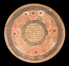 11 sycamore roundels in a circular beech box dating from around 1550 -1600.They are made from thin slices of wood, painted with strap work decoration and with a different moralising verse on each one. Roundels were used at large banquets and feasts where guests spoke or sang the verses painted on them. The box is painted with the Tudor coat of arms. Birmingham
