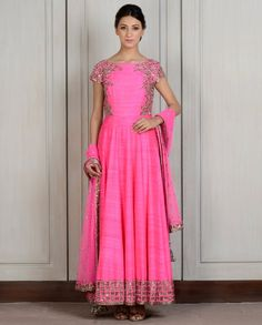 Fuchsia raw silk Kalidar with zardozi embroidery on the sides and intricately hand-sewn thick cut-dana geometric border. Boat neck with deep V back and short sleeves.