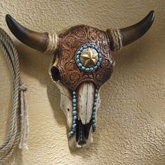 Embellished Skull Accent from Midnight Velvet®. This iconic image of the desert is given a bit of southwestern flair with the look of turquoise, silver, rope and tooled leather--all (including the skull) artfully rendered in resin.