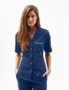 The Button Down Top in Estate Navy Blue is a contemporary addition to women& medical scrub outfits. Shop Jaanuu for scrubs, lab coats and other medical apparel. Vet Scrubs, Medical Scrubs, Dental Scrubs, Scrubs Outfit, Scrubs Uniform, Stylish Scrubs, Womens Scrubs, Nursing Clothes, Medical Uniforms