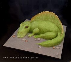 The birthday boy wanted a scary and mean looking Spinosaurus cake for his fifth birthday. This is my first sculpted cake too and was hand painted.