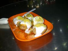 Dahi puri- an indian relish with puris stuffed with chick peas topped with curd and sev