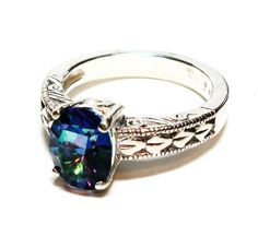 """Petalite ring, rainbow ring, solitaire ring, blue pink green teal, engagement ring, s 6 3/4   """"Teardrops in the Rain"""" by Michaelangelas on Etsy"""