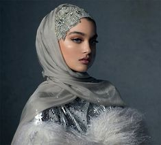 Discover unsurpassed glamour with the Celestial Silver hijab. Custom-designed crystal embellishments adorn the caplette for a royal look, paired with two opulent silver hijabs for infinite styling options. Muslimah Wedding Dress, Disney Wedding Dresses, Muslim Brides, Pakistani Wedding Dresses, Muslim Women, Muslim Couples, Street Hijab Fashion, Muslim Fashion, Bridal Hijab Styles