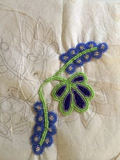 Floral Ojibway beadwork process by Wanesia Spry Misquadace