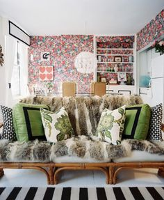Bohemian Living Room Photo - A vintage bamboo couch covered with a fur throw and green pillows