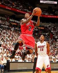 Nate Robinson #2 of the Chicago Bulls shoots a layup against Mario Chalmers #15 of the Miami Heat in Game One of the Eastern Conference Semifinals during the 2013 NBA Playoffs  http://www.fansedge.com/Nate-Robinson-Chicago-Bulls-Semifinals-Game-1-562013-_463031787_PD.html?social=pinterest_pfid77-36089