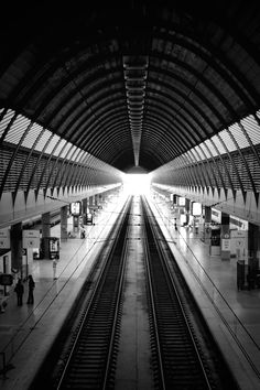 Featured photo by Ghost Presenter. Check out Ghost's profile: https://www.pexels.com/u/ghostpresenter/ #black-and-white #tunnel #architecture