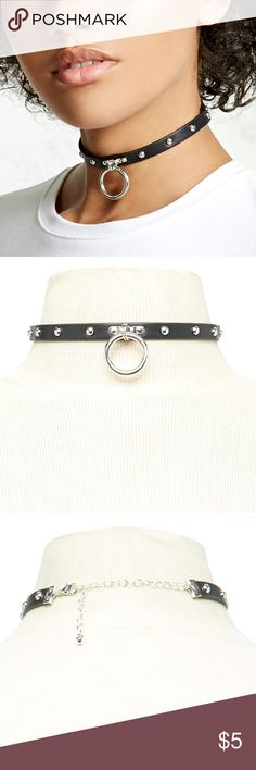 "F21 Studded O-Ring Collar Choker FOREVER 21 Studded O-Ring Collar Choker Please NOTE: This chocker was used ONCE, and is in NEW condition!  A faux leather collar-style choker featuring an O-ring charm, and high-polish studs throughout, with a lobster clasp closure.  - Made in China - Length: 11"" - Width: 0.375"" - Décor: 1"" x 1""  If you have any additional questions, please feel free to COMMENT!  I will be more than happy to satisfy your purchase.  xx Forever 21 Jewelry Necklaces"