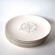 Vintage Saucers Atomic Teal Blue Plates Set of 6 Retro Space Age. $22.00, via Etsy.
