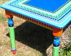 ATTENTION! This specific side table has been sold and is no longer available. It is pictured here only to show an example of my work. A piece similar in style and size to this one would run in the neighborhood of $495.00. Contact me for details on having a custom piece of furniture painted for you!  This table has been sold, but let me custom make a hand painted piece of furniture for you!  Please contact me for details on having a custom piece of furniture painted for you!  Purchase this…