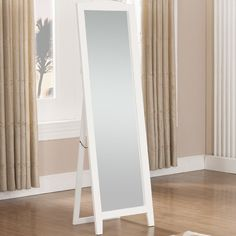 Round out your space in transitional flair with this clean-lined standing floor mirror, showcasing a full-length design and crafted from manufactured wood. Its slightly curved top adds visual appeal to any space while its solid finish blends effortlessly into both monochromatic and vibrant color palettes. Lean into this piece's traditional inspiration by adding it to a living room comprised of floral-pattern arm chairs and deep tufted loveseats, then anchor the arrangement with a round co...