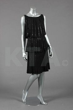 A Norman Hartnell couture beaded black wool cocktail dress, late 1960s
