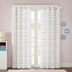 Make your space playful and fun with the Regency Heights Chloe Pom Pom Grommet Top Window Curtain Panel. The lightweight white panel features an all-over pom pom design in red, teal, purple and yellow. Brighten up any space with its contemporary look.