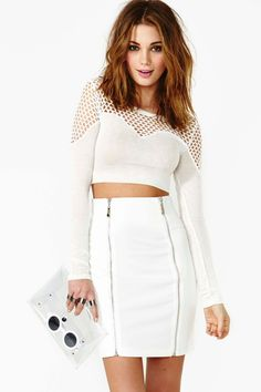 I love how the white skirt fits and the idea of the fishnet crop top. White is a great colour choice as well and makes the outfit look clean and classy.
