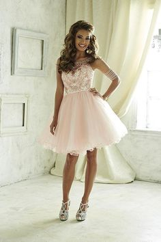 Illusion neckline with sweetheart lining on fully beaded bodice, and a two-tone, tulle short skirt. Lace-up back. Perfect for prom, Quinceanera, homecoming, bridesmaids, formal or social occasions. Do