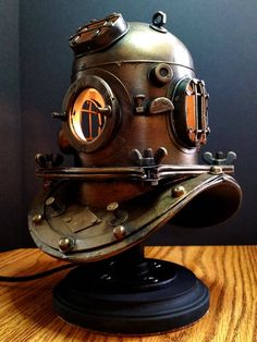 Give your home a vintage Steampunk look with this custom made diver lamp. Crafted using a miniature diving helmet, the interior is fitted with a small light bul Steampunk Kitchen, Mode Steampunk, Style Steampunk, Steampunk House, Steampunk Lamp, Steampunk Home Decor, Steampunk Robots, Steampunk Artwork, Home Office Decor