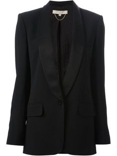 An elegant blazer 10 Wardrobe Essentials Every Woman Should Own: Glamour.com