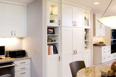 Transitional Open Concept Remodel Pantry and Hidden Fridge Cabinets from Dura Supreme Cabinetry.