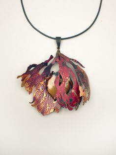 "Pendant   Olivia Shih.  ""Flourish"". 2013. Copper, brass, sterling silver, enamel."