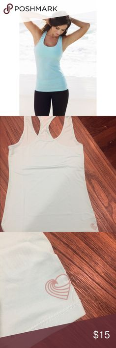 TIU Extra Mile Teal Racerback Tank This is brand new, not in packaging. Size medium. There is a silver TIU heart at the bottom hem. This is a long tank, good for you tall ladies! Tone It Up  Tops Tank Tops