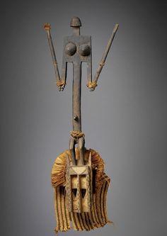 Africa | Dogon face mask.  Sanga Village, Mopti, Mali. | ca early 20th century | Kapok wood, pigments and vegetable fibers.