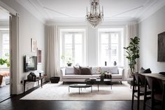 Tour a Refined Apartment With a Tasteful Blend of Styles - Nordic Design Wooden Floors Living Room, Wooden Flooring, Dark Floor Living Room, Beige Sofa, Nordic Design, Guest Bedrooms, Contemporary Furniture, Old And New, Decoration