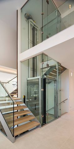 MD: Residential glass elevator and stairs. Stair Elevator, Elevator Design, Glass Elevator, Elevator In House, Spiral Stairs Design, Staircase Design, Stairs Architecture, Residential Architecture, Custom Home Builders