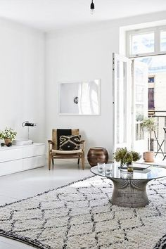 Scandinavian living woven textiles very cool how they integrated the  knoll pfister table into this room