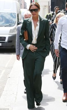 Gorgeous in green: Victoria Beckham power dressed in an emerald suit as she enjoyed swanky star-studded breakfast, in Mayfair, London on Tuesday