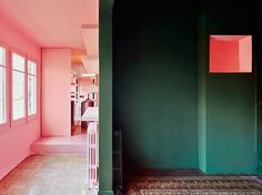 In his Barcelona home, Guillermo Santomà used vibrant shades of green, pink, and blue to delineate space and create a beautifully saturated backdrop.