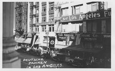 Deutsche Fahnen, German Flags, on Broadway Street in Los Angeles in April, 1936.  Jewish Federation Council of Greater Los Angeles' Community Relations Committee Collection. In Our Own Backyard Digital Exhibit.