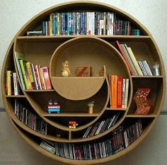 OP SAYS: DIY circular bookcase made from cardboard! I am becoming very obsessed with the idea that most things in our house will be reused, sustainable based from bookshelves, coffee tables, on and on. Allows your creative side to show. Helps the earth and allows us to teach our children what sustainable, recycle based thinking can mean to the Earth.