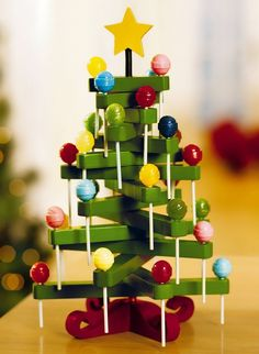 Clothespin lollipop tree. http://hative.com/cute-clothespin-crafts-and-ideas/