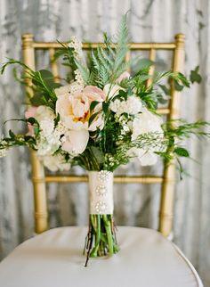 bouquet with leafy greenery - photo by Brandi Smyth http://ruffledblog.com/industrial-wedding-in-shreveport #weddingbouquet #bouquets